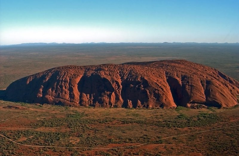 view of Uluru (Ayers rock) from a helicopter
